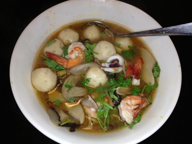 Tom yam soup with prawns squid and fish balls