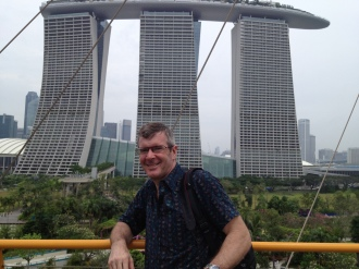 with the Marina Bay Hotel in the background - there is a pool on the roof