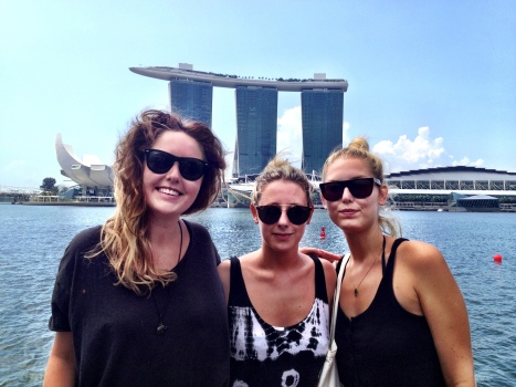 My three visitors on the bum-boat -Marina Bay Sands hotel in background