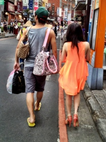 Hip couple strolling in Tamsui - check those heels!