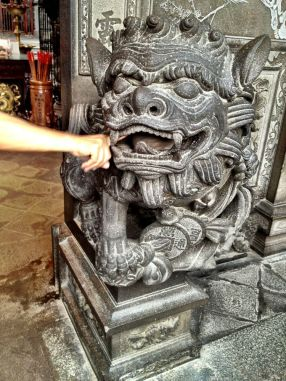 Carved temple guardian - even ball in his mouth is from one piece of stone