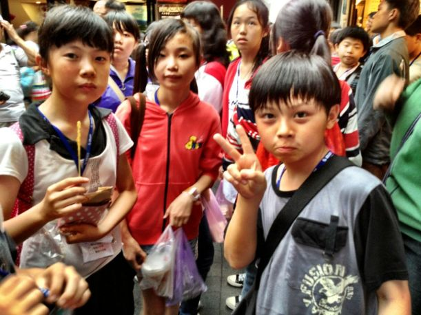 School kids saying Hi! THe ubiquitous 'peace' sign