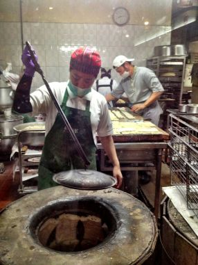 making the crispy bread - rather like a tandoor