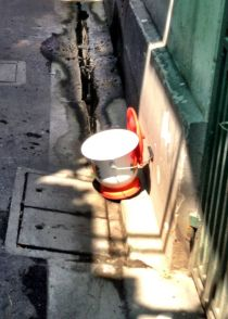 A slop bucket drying in the sun, a reminder of how everyone lived and some still do...but not for long I guess