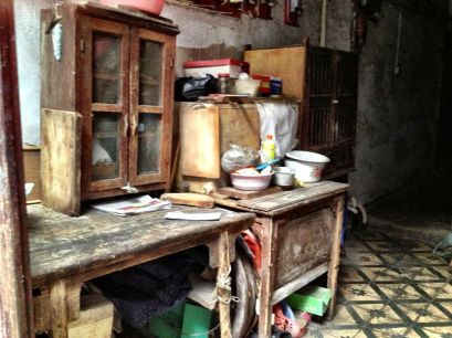 and shared cooking facilities, note old furniture ad floor tiles