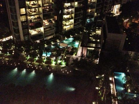 View from our balcony at night, overlooking the pool