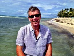 Cebu: Ross on the last morning - the sun is briefly out after the typhoon of the night before; but the waves were big on the way back