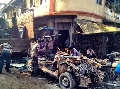 Stripping a car down to its component parts in Chor Bazaar