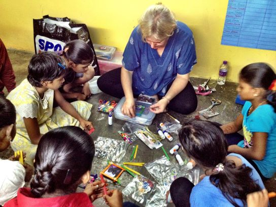 Mumbai red light district: Cindy getting down to work, kids looking on with rapt attention