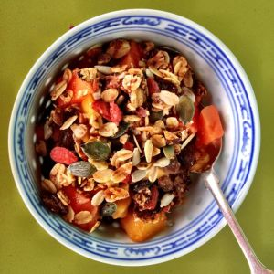 Home-made granola with tropical fruit