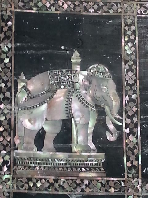 Mother of pearl elephant decoration at the foot of The reclining Buddha