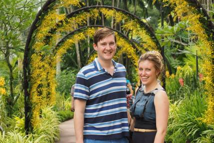 Sing: Tommy and Olivia under a bower of yellow orchids