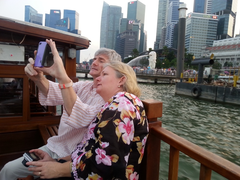 Cindy  & Guy taking selfies on the Singapore River cruise
