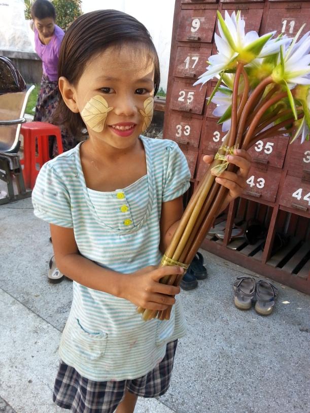 Lotus flower seller outside temple in Mandalay