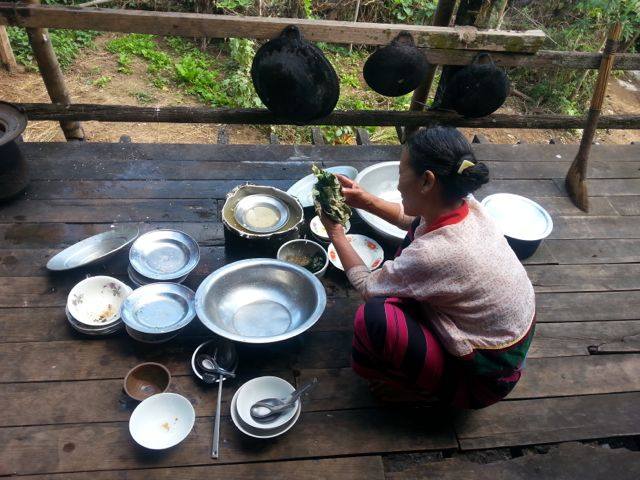 Amaung's mother doing the washing up