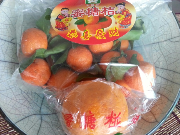 It's Chinese New Year next week - these jolly mandarins are everywhere; a taxi driver gave me teh big one!