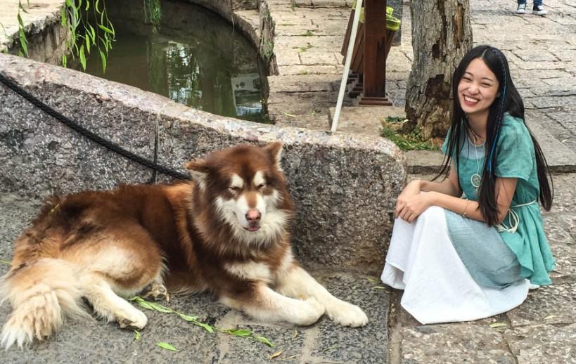 Girl posing with dog