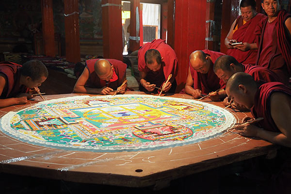 The monks making a mandala from sand (courtesy Ross Cattell)