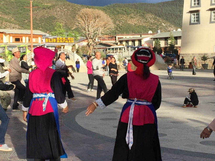Tibetan ladies dancing in the evening sunlight