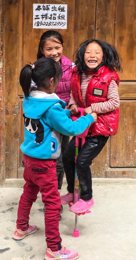 Tibetan girls pogo-ing