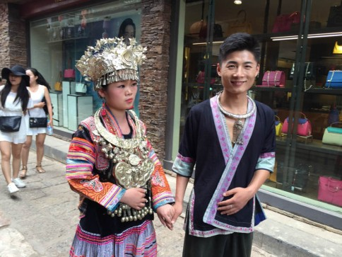 Couple dressed in Miao tribal costume