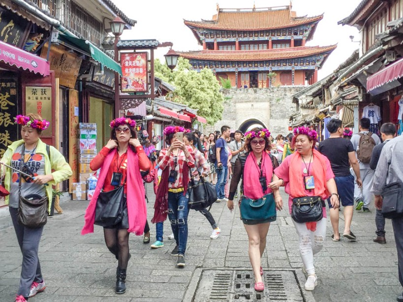 Gaggles of women in garlands marching through the old town