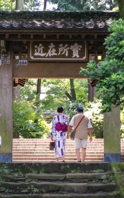 A couple on a day out at a shrine in Kamakura, she in kimono