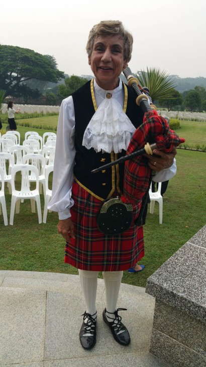 The lady piper, on day 2, at the Kranji War Cemetery