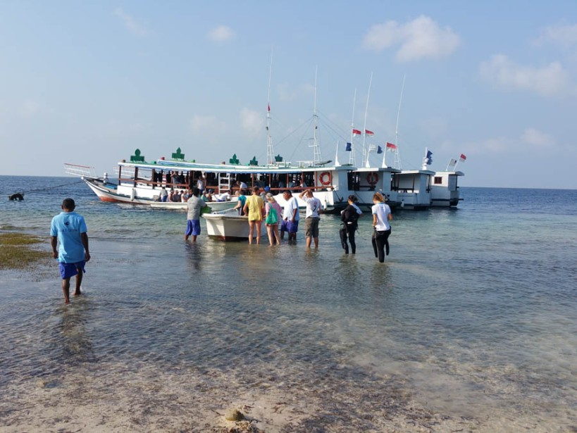 Getting ready to dive at low tide - we have to get ferried out on taxi boats