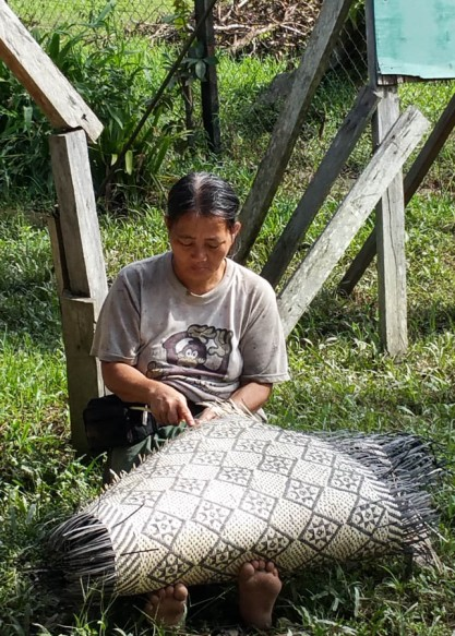 Penan woman weaving