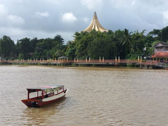The Sarawak river that divides Muslim and Chinese communities