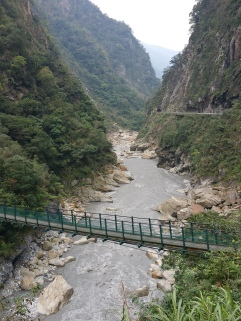 Suspension bridge leading to a trail, closed due to rock falls