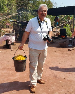 Diego carrying the corn to the still