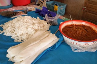 Local version of spaghetti- rice noodles with meat sauce!