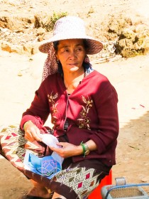 Hmong woman doing intricate embroidery