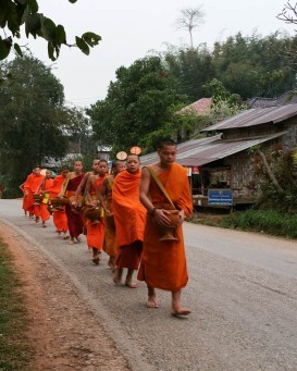 Monks processing to collect arms at Muang La village