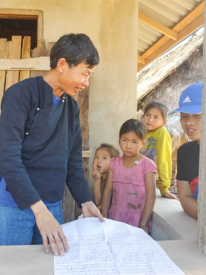 Village leader showing us his guiding documents