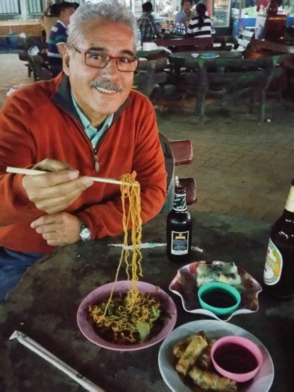 Deig relishing his night market noodles