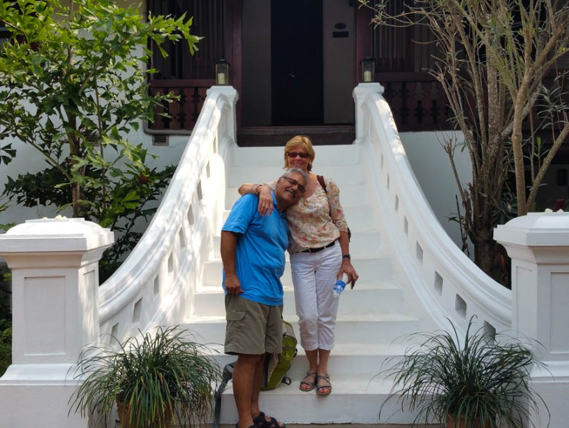 Chrsitine and Diego posing on teh steps to their room