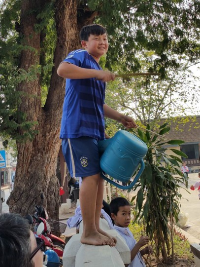 Drumming up support for the football on a watering can!