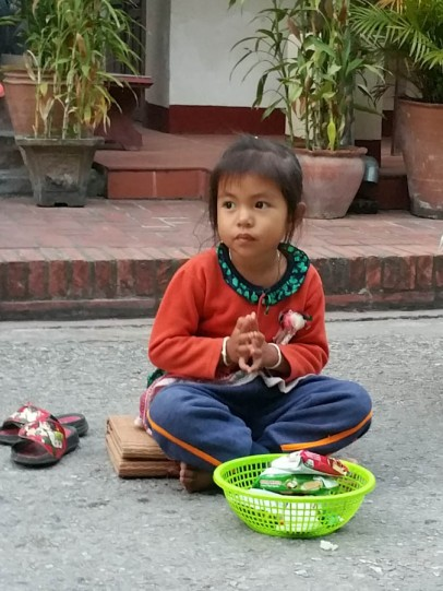 A young alms giver