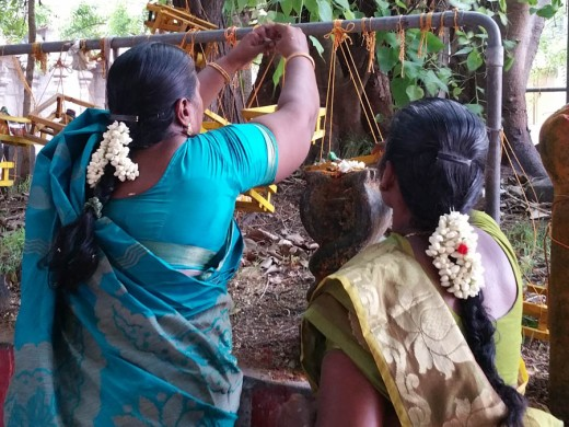 Tying on the cradles - for sale naturally in the temple