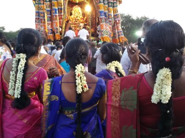 Devotees, all with jasmine and best saris