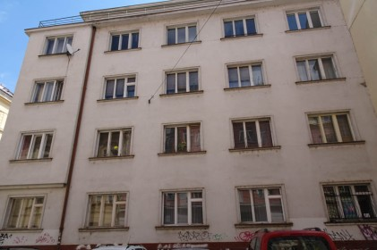 The concrete building that replaced the luxury apartment owned by our grandmother's parents in Smichov