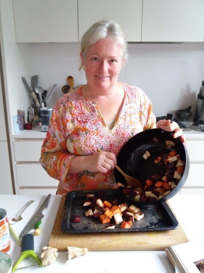 Cindy preparing home-grown beetroot and sweet potato curry