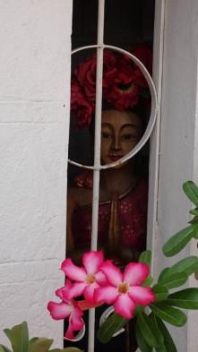 Balinese lady peeking through...