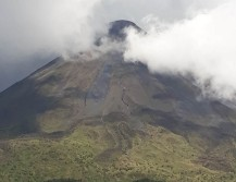 Moody volcano in and out the clouds