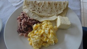 Local breakfast - tortilla, gallo pinto, hard cheese and eggs