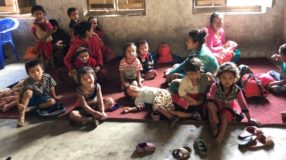 Mothers and babies waiting for vaccinations