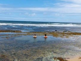 two lonely bathers looking east towards Ireland